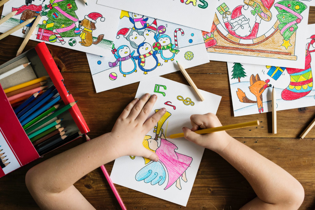 Bird's eye view of child drawing on paper