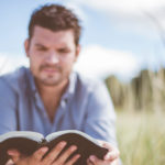 Man reading, out of focus