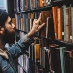 Man selecting book at library